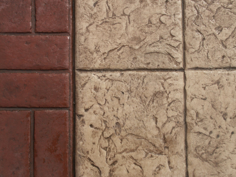 Close up photo of a basketweave brick border with 12x12 tile stamped concrete.