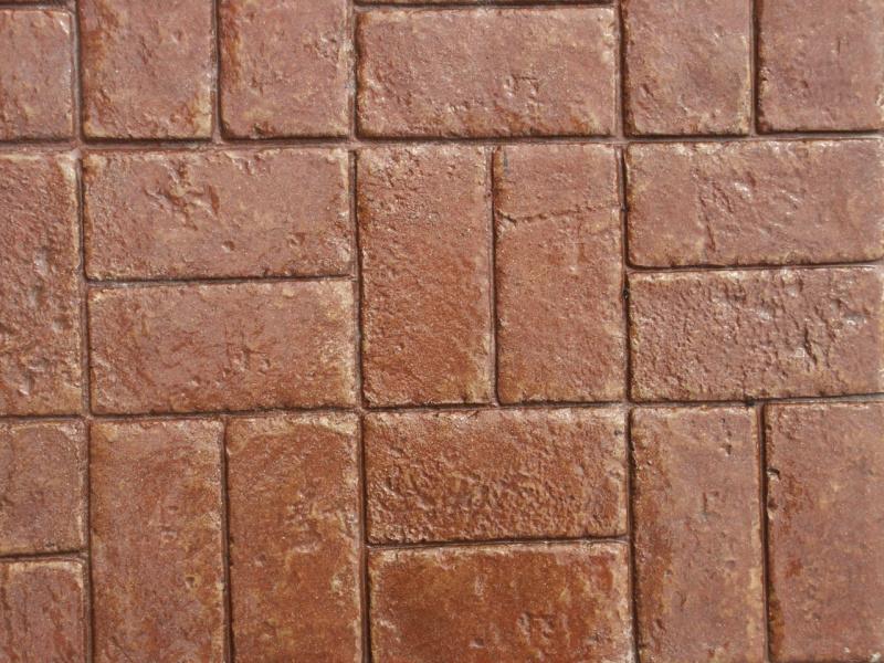 Closeup photo of a Basketweave brick concrete stamp.