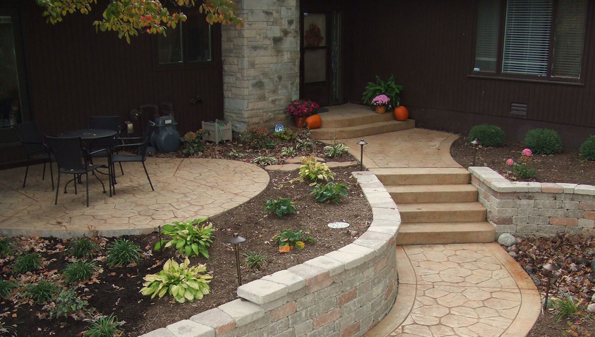 Residential Concrete - A sandstone walkway with steps in front of a house