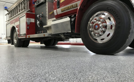 Poly Coated Garage Floor With Firetruck Parked Atop