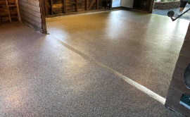 Poly Coated Garage Floor With Work Space