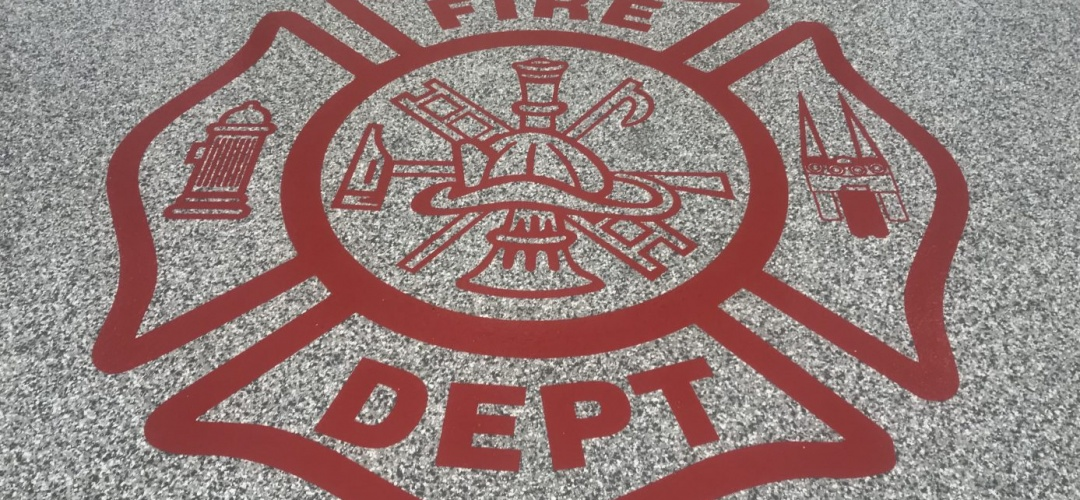 Poly coated Fire department floor with insignia atop