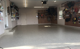 Poly Coated Garage Floor With Tools Hanging On The Walls