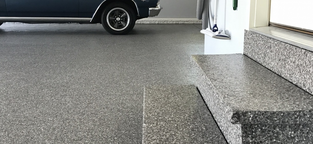 Poly coated floor & stairs with classic car parked inside