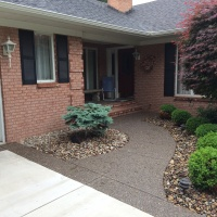 Exposed Aggregate Entry Walk Way In Front Of A House