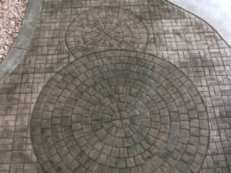 radial stone stamped decorative concrete near a pool