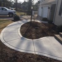 Winding Entry Way With A Broomed Border